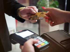 man using a credit card could be a good candidate for debt consolidation