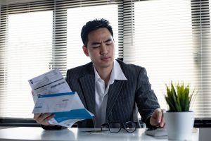 a man is calculating how much he needs for a debt consolidation loan